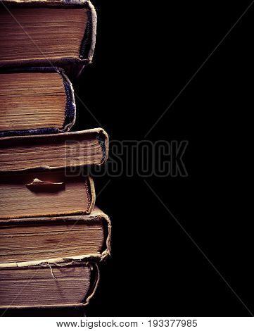 Old used book isolated on the black background.