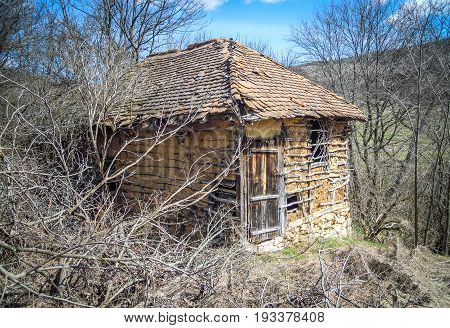 Abandoned Serbian village. Old shed in abandoned mountain village in Serbia.