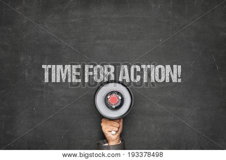 Time for action on black blackboard with megaphone