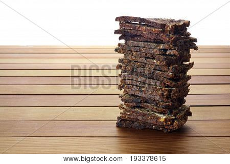 Stack of Crispbread on a Wooden Background