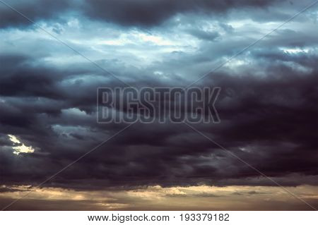 Background of dark clouds before a thunder-storm. Storm clouds in the dark sky. The dark background of bad weather.
