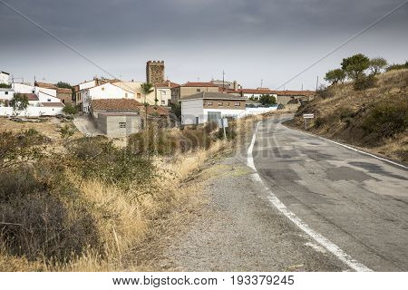 paved road passing through Badenas village, province of Teruel, Aragon, Spain