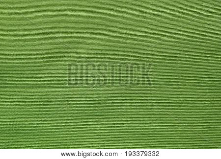 Fabric Texture Close Up of Green Olive Cotton Pattern Background with Copy Space for Text Decoration.