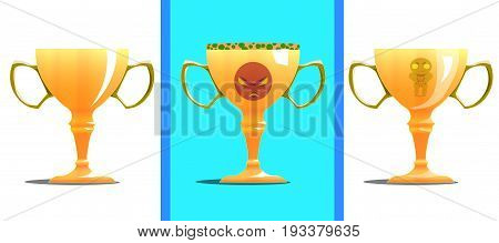 Three congratulatory gold cups for sport. One cup is simple. The second cup has the image of an evil face. On the third goblet, a small pattern and a print in the form of a strongman.