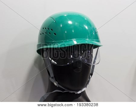 a mannequin with Safety helmets on a shelf ; Working Hard Hat;Personel Protection Equipment PPE