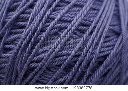 Ball of lilac yarn. Closeup texture, macro