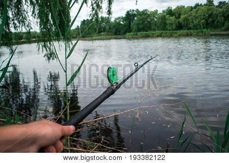 The fisherman is fishing on the pond
