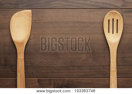 wooden skimmer and spatula, kitchen tools on the table with copy space