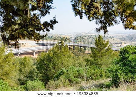 The Shomron mountains and Cross-Israel Road (road 5) from where the road enters the West Bank. Taken from the hills of Rosh Haayin one of the fastest growing cities in Israel.