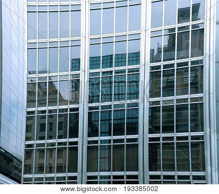 Reflection on modern glass facade building exterior