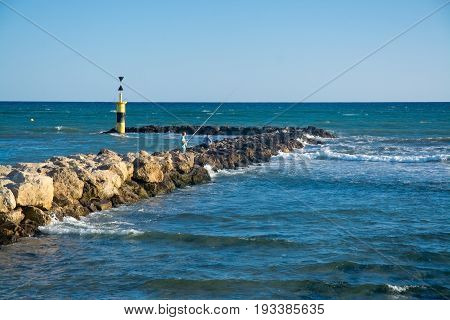 Men Fishing From The Pier