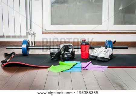 Fitness exercise equipment. Fitness equipment for woman on the floor of home apartment. In home workout.