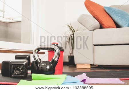 Fitness exercise equipment on the floor. Woman fitness equipment. Home apartment. In home workout training.