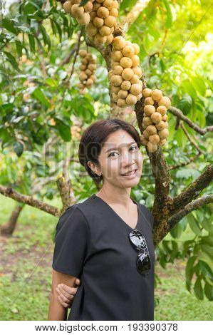 Asian woman with wollongong tree in the garden