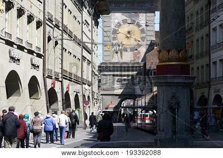 Bern Switzerland - April 20 2017: Crowded traffic on the street. In the background you can see a large clock tower which is one of the most recognizable landmarks of the city