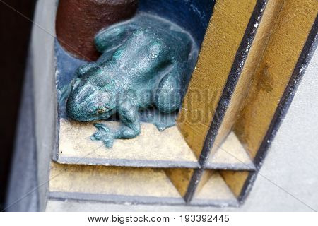 Bern Switzerland - April 17 2017: The frog an architectural art detail found in the hollows of the old building's elevation in the old city beautifies the ordinary walls.
