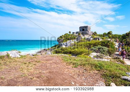 Tulum Mexico - April 20 2016: Sea view from the Mayan city archaeological site with tourists on the right