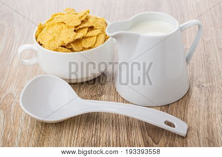 Corn Flakes In White Bowl, Plastic Spoon And Milk
