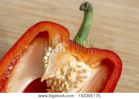 Closeup Of Red Bell Pepper Sliced In Half, Seeds And Juicy Flesh In Detail