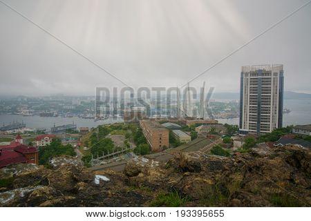 port city view from the heights, high Bay braced bridge, thick fog. Marine City. Vladivostok