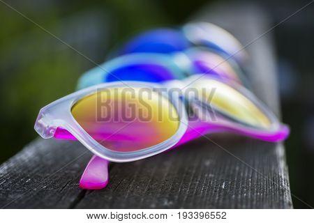 Three Pairs Of Vibrant Sunglasses In Multiple Colors