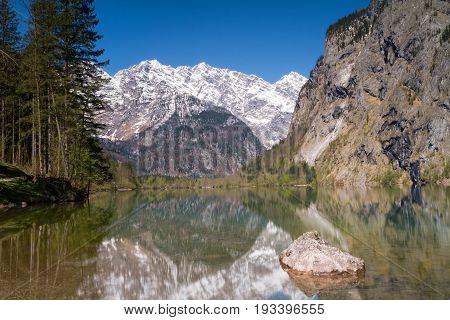 Watzmann moubntain range reflecting at Lake Obersee Bavaria Germany