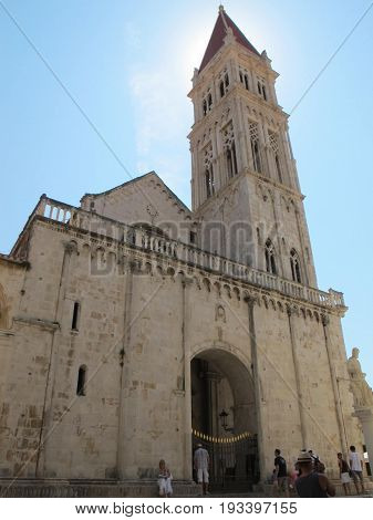 Tall beautiful cathedral in Trogir under the midday sun