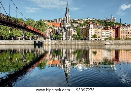 Morning view on the riverside with saint George cathedral and footbridge in the old town of Lyon city