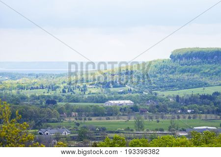 Edge Of Escarpment Cliff And Valley With Lake Seen From High Above