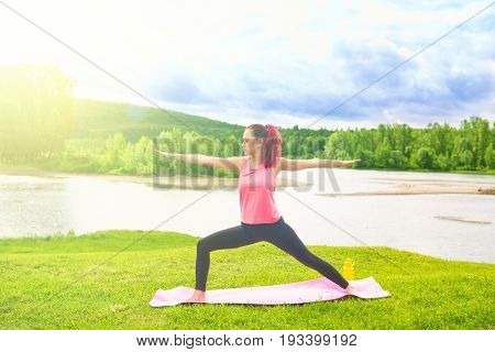 Yoga Girl Pose Practicing Outdoors. Yoga At Park. Concept Of Healthy Lifestyle