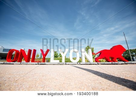 LYON, FRANCE - May 21, 2017: Letters with figure of a lion near the new museum of confluences in Lyon city