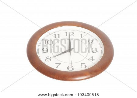 Round office clock showing eight o'clock isolated on white background