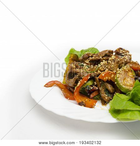 juicy slices of veal with grilled vegetables under a spicy sauce, sesame emphasizes a symphony of aftertaste
