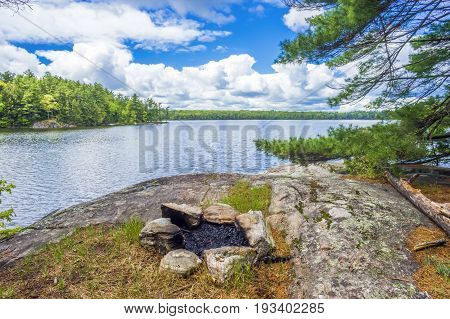 Circle Of Stones Campfire Pit Near Water In Remote Canadian Wilderness