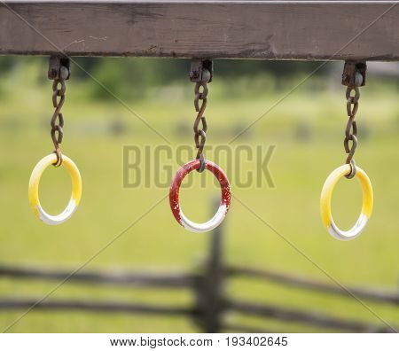 Play Equipment Rings Hanging From Wooden Post