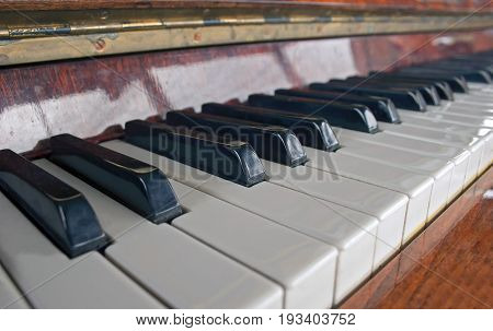 The Old Piano With Worn Keys