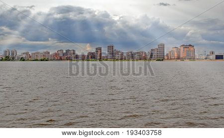 The Cityscape In The Background Of The River With Sun Rays