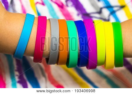 Rubber Bands On Hand. Girls Hand With Bracelets Made Of Rubber Bands. Rainbow Loom Colored Rubber Ba