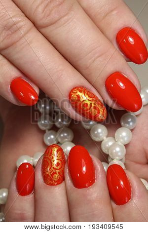 Red Manicure With Pearls