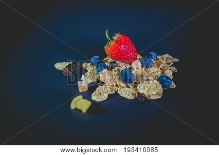 whole grain cereal flakes which mixed berry fruit and raisins. Cereal breakfast with strawberry. cereal corn flakes with blueberry