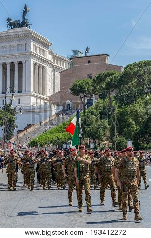 ROME; ITALY - JUNE 2; 2017: Military parade at Italian National Day. Soldiers in formation. The Monument a Vittorio Emanuele II in background.
