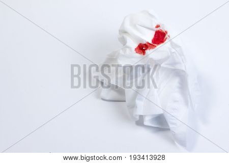Wound Blood, Blood On Tissue Paper On White Background. Nosebleed Or Epistaxis Treatment Blood In Ti