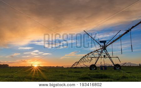 Irrigation farm system in New Zealand at Sunset.