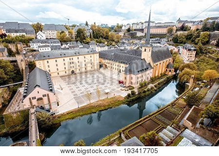 Top view on the Grund district with saint Johns church and Neumunster abbey in Luxembourg city