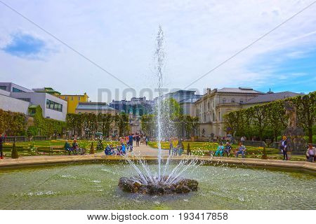 Salzburg, Austria - May 01, 2017: The beautiful Mirabell gardens in Salzburg. It is a popular destination visited by tourists at Salzburg, Austria on May 01, 2017