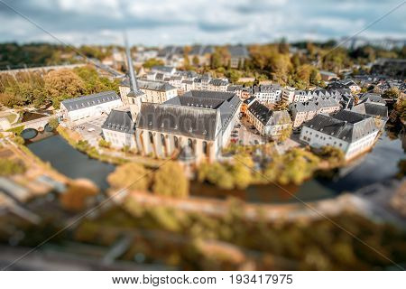 Top view on the Grund district with saint Johns church and Neumunster abbey in Luxembourg city. Tilt-shift image technic