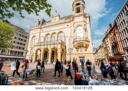 LUXEMBOURG, LUXEMBOURG - May 18, 2017: View on Cercle Municipal building with people walk on the Armes square in Luxembourg