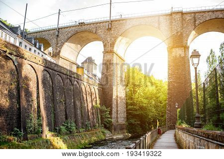 View from below on the old railway bridge in Luxembourg during the sunset