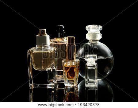 Perfume bottles on black background