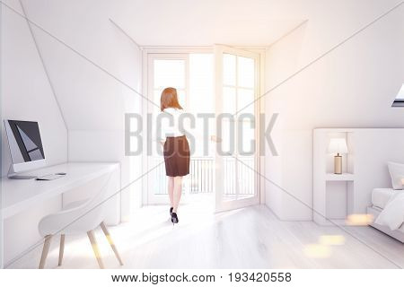 Woman in a white attic bedroom with a home office white walls and wooden floor a table with a computer and a bed. 3d rendering mock up toned image
